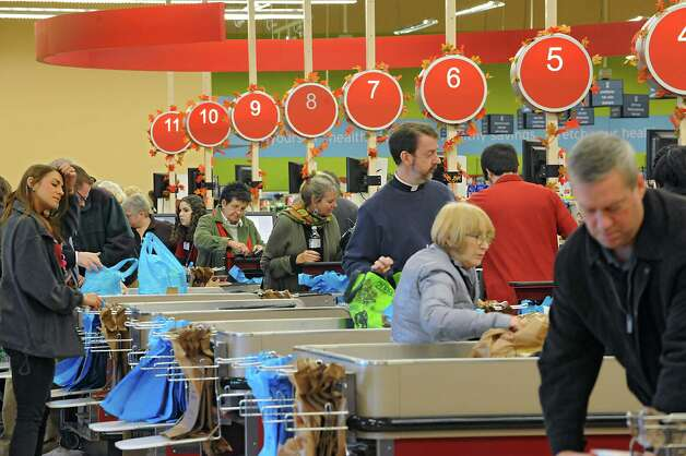 Shoppers are checked out at the registers in the Hannaford supermarket in Latham Farms on Tuesday, Nov. 25, 2014 in Latham, N.Y. People are getting ready for a snow storm tomorrow and then Thanksgiving on Thursday. (Lori Van Buren / Times Union) Photo: Lori Van Buren