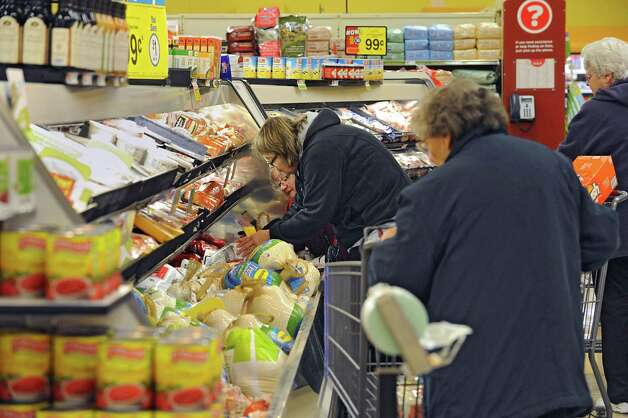 Women pick out turkeys in the meat department in the Hannaford supermarket in Latham Farms on Tuesday, Nov. 25, 2014 in Latham, N.Y. People are getting ready for a snow storm tomorrow and then Thanksgiving on Thursday. (Lori Van Buren / Times Union) Photo: Lori Van Buren