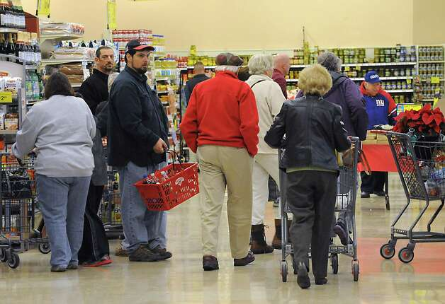 Shoppers make their way to the registers in the Hannaford supermarket in Latham Farms on Tuesday, Nov. 25, 2014 in Latham, N.Y. People are getting ready for a snow storm tomorrow and then Thanksgiving on Thursday. (Lori Van Buren / Times Union) Photo: Lori Van Buren