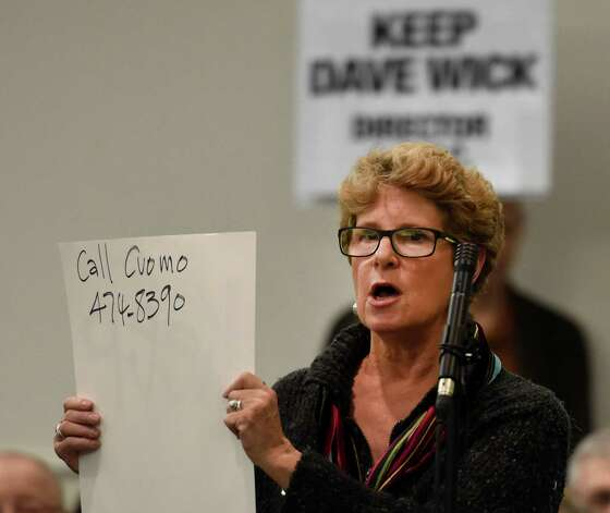 Susan Weber calls for Wick supporters to call Governor Cuomo as speaks in support of Dave Wick during an overflow turnout in to the conference room at the Fort William Henry Conference Center Tuesday morning Nov. 25, 2014  in Lake George, N.Y.  for a meeting of the Lake George Park Commission.  Wick, Executive Director of the Lake George Park Commission was put on paid leave recently much to the dismay of most all of the attendees to this commission meeting.  (Skip Dickstein/Times Union) Photo: SKIP DICKSTEIN / 00029607A