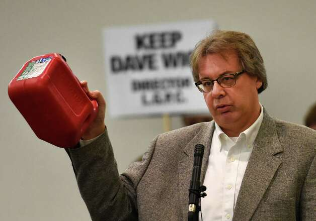 """Chris Navitsky holds up a gallon can to signify the amount of the gasoline spill involved in Dave Wick being put on paid leave, speaks in support of Wick during an overflow turnout in to the conference room at the Fort William Henry Conference Center Tuesday morning Nov. 25, 2014  in Lake George, N.Y.  for a meeting of the Lake George Park Commission.  Navitsky coined the phrase """"gallon gate"""".  Wick, Executive Director of the Lake George Park Commission was put on paid leave recently much to the dismay of most all of the attendees to this commission meeting.  (Skip Dickstein/Times Union) Photo: SKIP DICKSTEIN / 00029607A"""