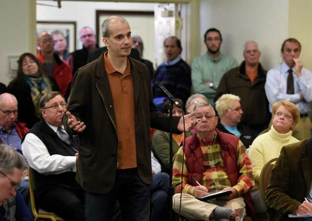 Bill Peirce(correct spelling), a personal friend,  speaks in support of Dave Wick during an overflow turnout in to the conference room at the Fort William Henry Conference Center Tuesday morning Nov. 25, 2014  in Lake George, N.Y.  for a meeting of the Lake George Park Commission.  Wick, Executive Director of the Lake George Park Commission was put on paid leave recently much to the dismay of most all of the attendees to this commission meeting.  (Skip Dickstein/Times Union) Photo: SKIP DICKSTEIN / 00029607A