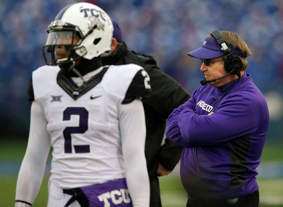 TCU head coach Gary Patterson and quarterback Trevone Boykin stand on the sideline during a play review in the first half against Kansas in Lawrence, Kan., on Nov. 15, 2014. Photo: Orlin Wagner /Associated Press / AP