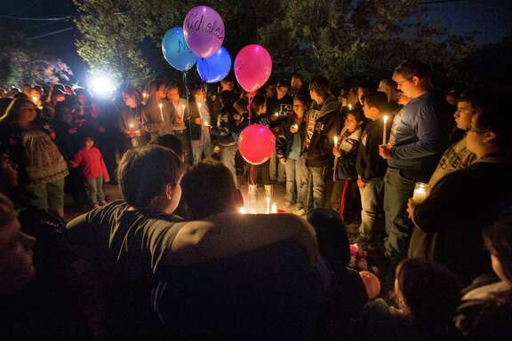 Mourners hold a vigil Tuesday evening near the mobile home where an early-morning fire killed five children in one family - above from left, Noah, 15; Nicholas, 13; Julian, 9; Ariana, 6; and Liliana, 5.