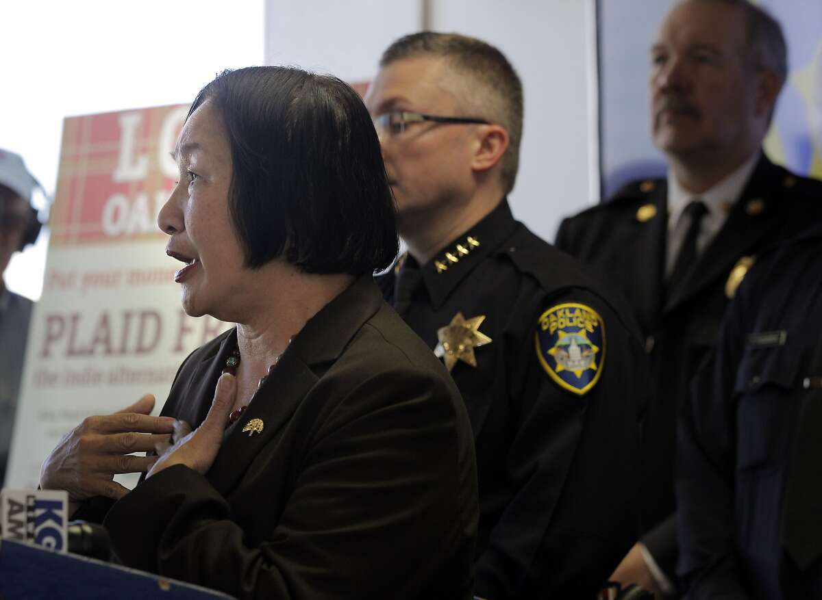 Oakland Mayor Jean Quan answers questions about the impact of the violent protests in Oakland following the grand jury decision in Ferguson, Mo. Oakland city officials spoke to the press about the local Ferguson protests overnight on Tuesday, November 25, 2014, at the Oakland, Calif, police headquarters.