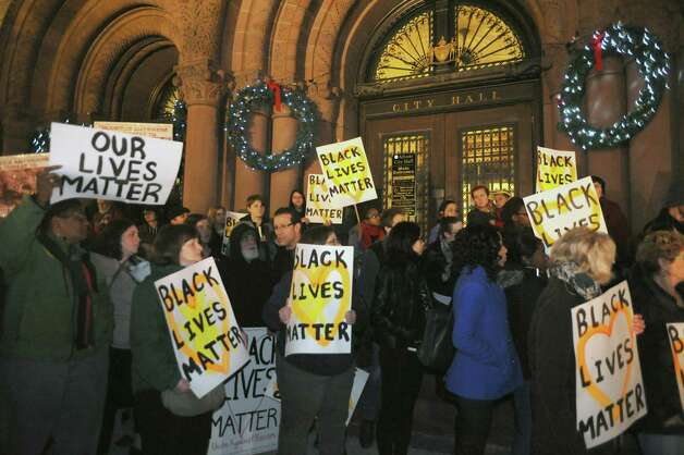 Protestors rally in response to the Ferguson, Mo grand jury decision , it would not indict Officer Darren Wilson, who is white, in the Aug. 9 shooting death of Michael Brown, 18, who was black, at City Hall on Tuesday Nov. 25, 2014 in Albany, N.Y. (Michael P. Farrell/Times Union) Photo: Michael P. Farrell / 00029620A
