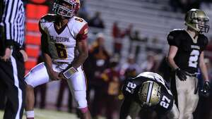 St. Joseph's Mufasa Abdul-Basir celebrates his goal Tuesday, Nov. 25, 2014, during their game against Trumbull at Trumbull High School. His touchdown early in the second half broke Trumbull's lead.