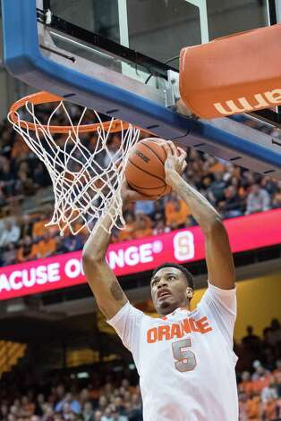 SYRACUSE, NY - NOVEMBER 25:  Chris McCullough #5 of the Syracuse Orange puts in two points during the first half against the Loyola (MD) Greyhounds on November 25, 2014 at The Carrier Dome in Syracuse, New York.  (Photo by Brett Carlsen/Getty Images) ORG XMIT: 521825415 Photo: Brett Carlsen / 2014 Getty Images