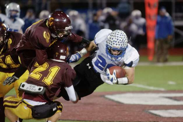 Hooski Falls' Colby Davendonis gets tackled by Fonda's Cam Ives during the Class C Superbowl game in Stillwater, NY Friday, November 7th, 2014. Hoosick Falls took the victory in the game. Photo By Eric Jenks Photo: Eric Jenks / Eric Jenks 2014 www.awasos.com