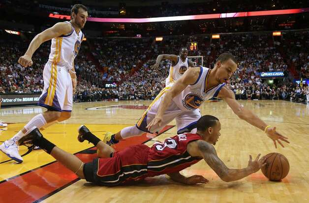 MIAMI, FL - NOVEMBER 25: Shabazz Napier #13 of the Miami Heat and Stephen Curry #30 of the Golden State Warriors fight for a loose ball during a game  at American Airlines Arena on November 25, 2014 in Miami, Florida. NOTE TO USER: User expressly acknowledges and agrees that, by downloading and/or using this photograph, user is consenting to the terms and conditions of the Getty Images License Agreement. Mandatory copyright notice:  (Photo by Mike Ehrmann/Getty Images) ORG XMIT: 508084567 Photo: Mike Ehrmann / 2014 Getty Images