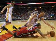 MIAMI, FL - NOVEMBER 25: Shabazz Napier #13 of the Miami Heat and Stephen Curry #30 of the Golden State Warriors fight for a loose ball during a game  at American Airlines Arena on November 25, 2014 in Miami, Florida. NOTE TO USER: User expressly acknowledges and agrees that, by downloading and/or using this photograph, user is consenting to the terms and conditions of the Getty Images License Agreement. Mandatory copyright notice:  (Photo by Mike Ehrmann/Getty Images) ORG XMIT: 508084567