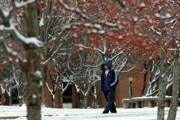 Freshman Danny Li, 18, walks through a snow-covered campus on Tuesday, Nov. 26, 2013, at Siena College in Loudonville, N.Y. (Cindy Schultz / Times Union) Photo: Cindy Schultz / 00024809A
