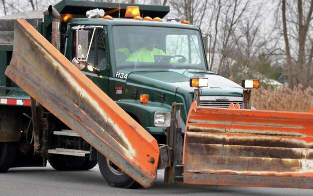 A Town of Colonie snowplow, ready for the coming storm, makes its way along Albany Shaker Road Wednesday morning Nov. 26, 2014, in Colonie, NY.  (John Carl D'Annibale / Times Union) Photo: John Carl D'Annibale / 00029647A