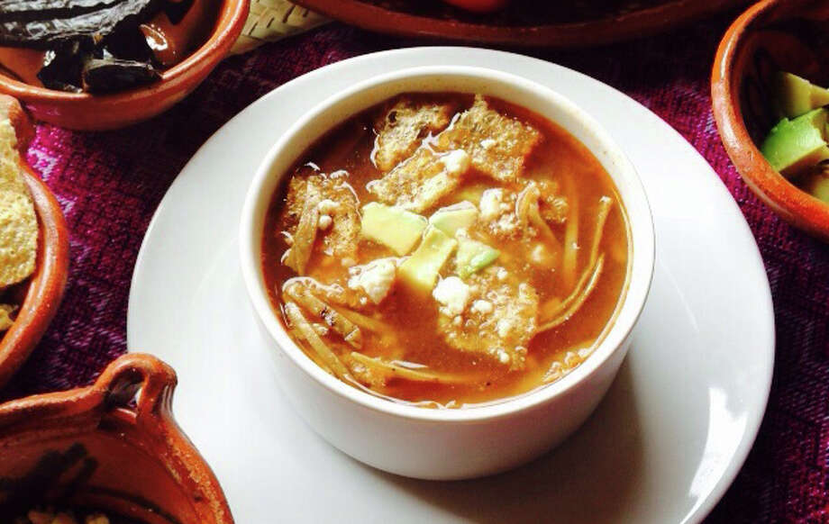 Toppings are added to the bowl first for Paloma Blanca's Sopa de Tortilla, or tortilla soup. (Courtesy photo) Photo: Courtesy Photo