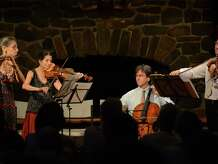 Members of the Sherman Chamber Ensemble, from left, Susan Rotholz, on flute, Jill Levy, on violin, Eliot Bailen, on cello, and Daniel Panner, on viola, will perform at the Sherman Congregational Church in Sherman, Conn., and St. Andrew's Church in Kent, Conn., on Saturday, Nov. 29, and Sunday, Nov. 30, 2014, respectively.