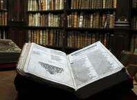 The newly discovered Shakespeare's original first folio is seen in the Saint-Omer library, northern France, Wednesday, Nov. 26, 2014. The accidental discovery in the small library in northern France of an original first folio of the bard's plays _ one of the rarest books in the world _ has sent jitters of excitement around the world of Shakespeare enthusiasts, especially those partial to the theory that the bard was a secret Catholic.  The find brings the total of known folios in the world to 233, and is significant as each first folio can contain variations that shed light on Shakespeare's intentions. Among the 900 pages of the most recent discovery are rare annotations that suggest it was used for performance.  (AP Photo/Michel Spingler)