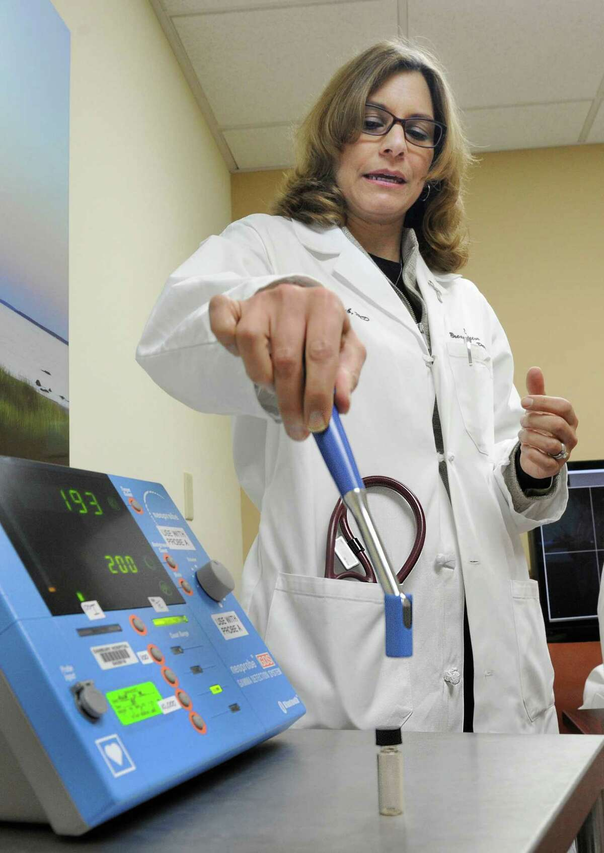 Dr. Valerie Staradub explains a technology that uses radioactive seed localization to remove spots on a woman's breast, Tuesday, Nov. 24, 2014 at Danbury Hospital. Western Connecticut Health Network is the first provider in the state of Connecticut to offer this new technology to accurately locate spots that cannot be felt.