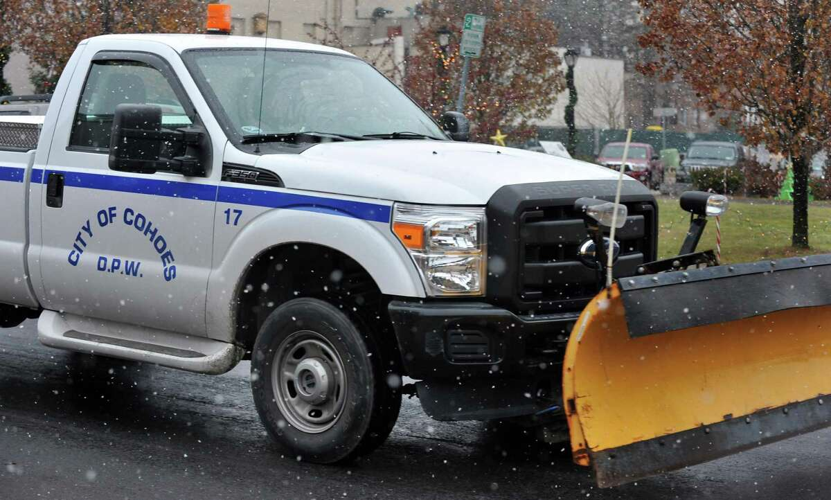 A City of Cohoes DPW truck with a snowplow patrols the streets as snow begins to fall Wednesday morning Nov. 26, 2014, in Cohoes, NY. (John Carl D'Annibale / Times Union)