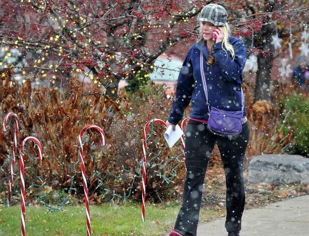 Shealyn Stopera of Cohoes cuts through Horace Stillman Park as snow begins to fall Wednesday morning Nov. 26, 2014, in Cohoes, NY.  (John Carl D'Annibale / Times Union) Photo: John Carl D'Annibale / 00029647A