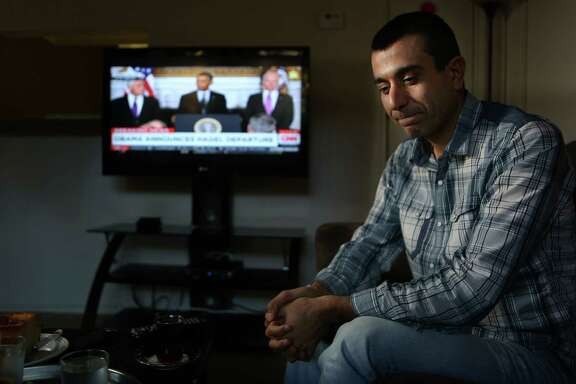 Murad Ismael, of Iraq, listens to a live White House press conference announcing Defense Secretary Chuck Hagel is stepping down. Ismael is concerned this will delay aid to his countrymen back home who have been terrorized by ISIS fighters on Monday, Nov. 24, 2014, in Houston.