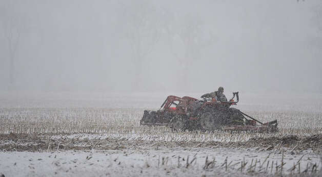 The snow didn't stop this farmer from working his field in Stuyvesant, Columbia County, on Wednesday, Nov. 26, 2014. Photo: Skip Dickstein