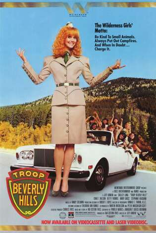 'Troop Beverly Hills' - Shelly Long stars as a spoiled Beverly Hills housewife who decides -- in an effort to disprove her husband's characterization that she's a selfish trophy wife -- to become the leader of her daughter's wilderness group. Failing miserably at first -- she takes them on outings at the mall rather than in the woods -- she later must prove her worth as a legitimate troop leader by instilling lessons of teamwork and selflessness in her young charges. Available Dec. 1 Photo: Handout