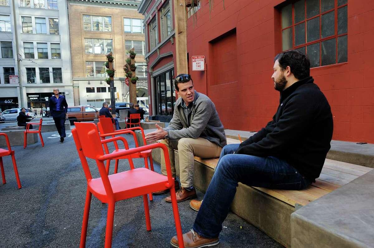 Mike Cornelius (left) and Ben Bellettini talk in the pedestrian-friendly plaza on Annie Street.