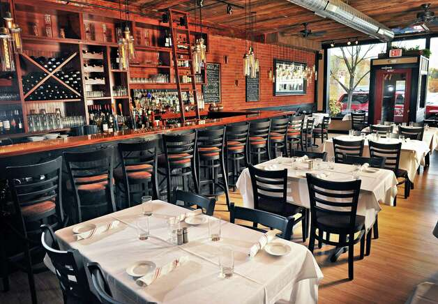Dining room at Next Door Kitchen & Bar on Front Street Tuesday Oct. 28, 2014,in Ballston Spa, NY.  (John Carl D'Annibale / Times Union) Photo: John Carl D'Annibale / 00029223A