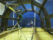 The new pitching machine at YWCA Greenwich throws curves, sliders, changeups, and fastballs up to 95 mph.