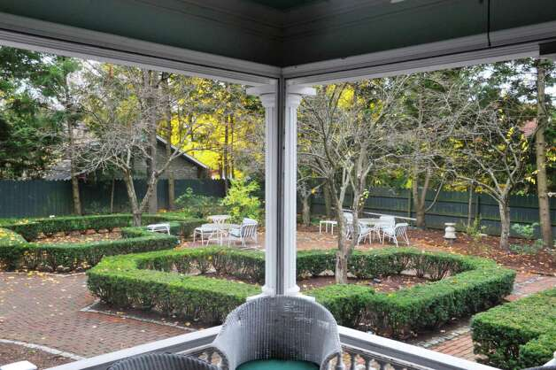 A view looking out of the porch at the backyard garden at 108 Circular  St. on Wednesday, Nov. 12, 2014, in Saratoga Springs, N.Y.  (Paul Buckowski / Times Union) Photo: Paul Buckowski / 00029396A