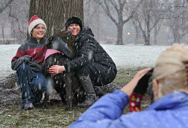 Jackie Nichols takes a photo of her nephew Reagan Lyon, 11, her sister Jennifer Imire and their dog Baxter in Washington Park during a snow storm on Wednesday, Nov. 26, 2014 in Albany, N.Y. The family from Glens Falls was trying out a new location to take their Christmas card photos.  (Lori Van Buren / Times Union) Photo: Lori Van Buren / 00029647A