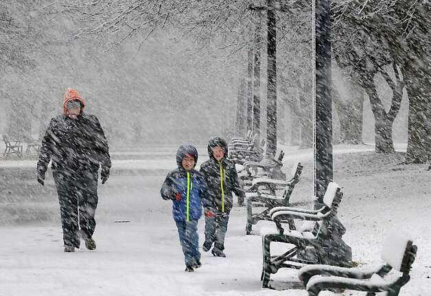 Christina Leibowitz of Atlanta, GA walks with her children Benjamin, 5, and Doss, 7, right, in Washington Park during a snow storm on Wednesday, Nov. 26, 2014 in Albany, N.Y. The family is visiting her sister-in law in Troy and are staying at the Morgan State House in Albany. (Lori Van Buren / Times Union) Photo: Lori Van Buren / 00029647A