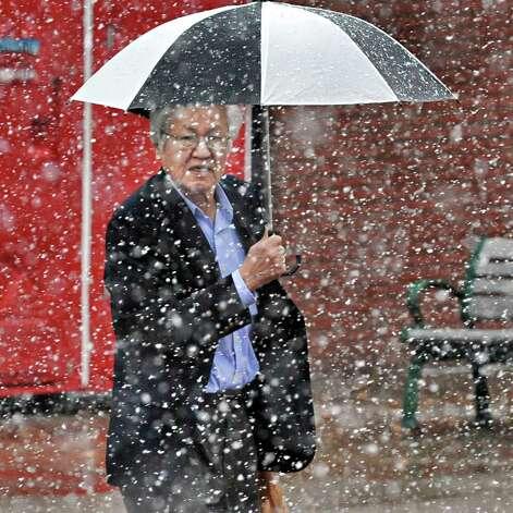 Minoru Tomozawa of Brunswick makes his way along 3rd Street as snow falls Wednesday Nov. 26, 2014, in Troy, NY.  (John Carl D'Annibale / Times Union) Photo: John Carl D'Annibale / 00029647A