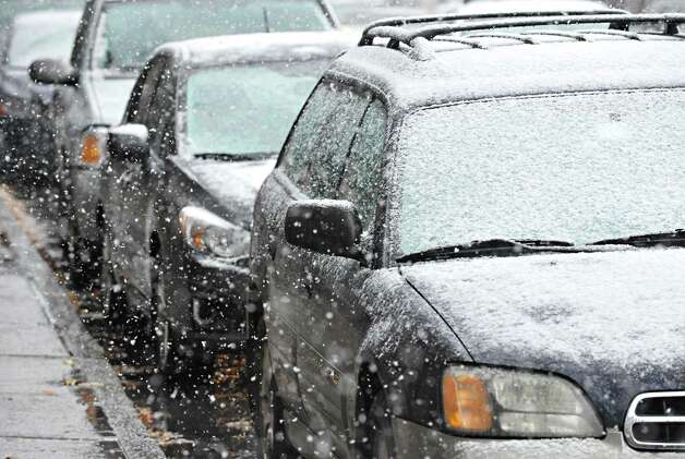 Snow begins to cover parked cars on 3rd Street Wednesday Nov. 26, 2014, in Troy, NY.  (John Carl D'Annibale / Times Union) Photo: John Carl D'Annibale / 00029647A