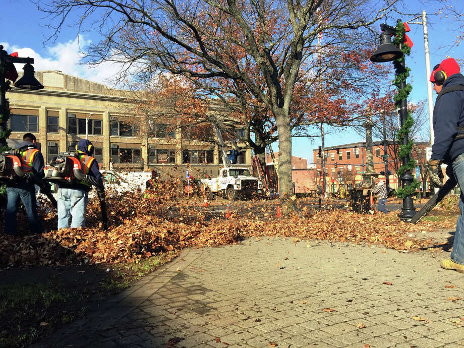City workers clear library plaza and string trees with lights in preparation for the annual Light the Lights celebration. Photo: Rob Ryser / The News-Times