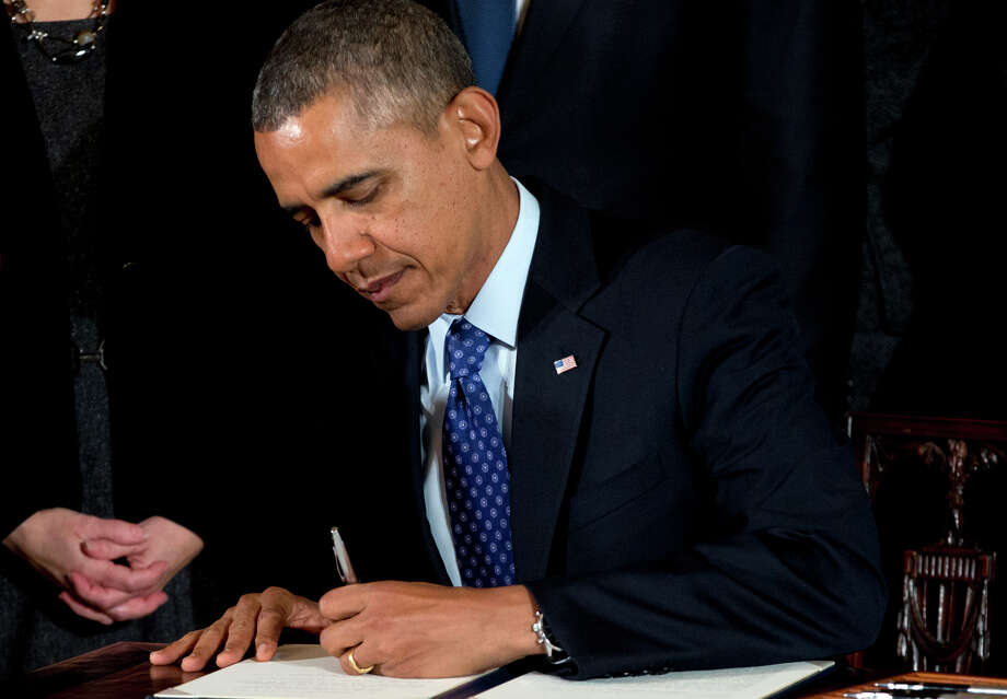 Responding to concerns about sexual assault on campuses, President Obama signs a memorandum creating a task force to respond to campus rapes during an event for the Council on Women and Girls at the White House. Photo: Carolyn Kaster / Associated Press / AP