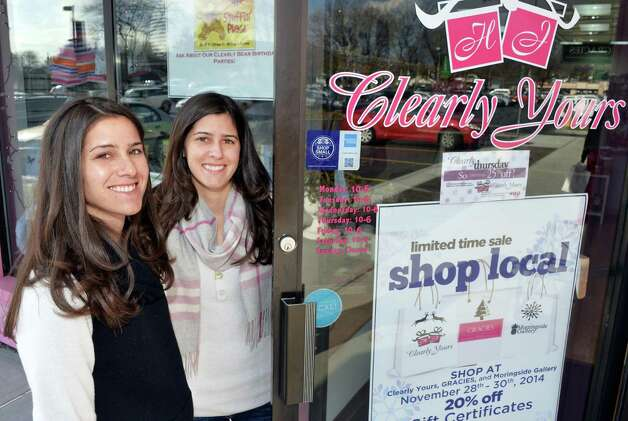 Twin sisters and co owners Heather Kruse, left, and Jodi Emmott outside their Clearly Yours store in Newton Plaza Thursday Nov. 20, 2014, in Colonie, NY.  (John Carl D'Annibale / Times Union) Photo: John Carl D'Annibale / 00029556A
