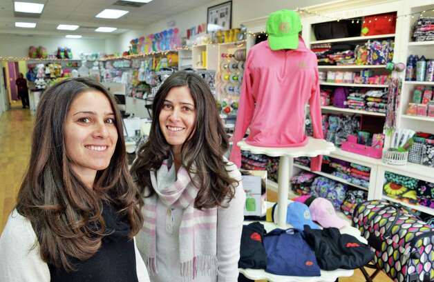 Twin sisters and co owners Heather Kruse, left, and Jodi Emmott inside their Clearly Yours store in Newton Plaza Thursday Nov. 20, 2014, in Colonie, NY.  (John Carl D'Annibale / Times Union) Photo: John Carl D'Annibale / 00029556A