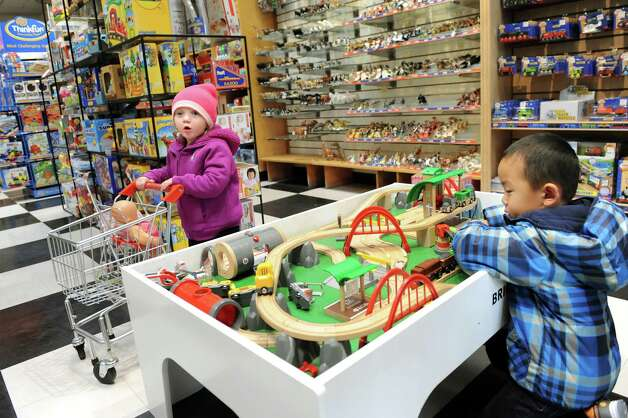 Ella Bonder, 2, left, and Jonathan Wu, 3, play as their parents shop for toys on Thursday, Nov. 20, 2014, at G. Willikers in Guilderland, N.Y. (Cindy Schultz / Times Union) Photo: Cindy Schultz / 00029569A