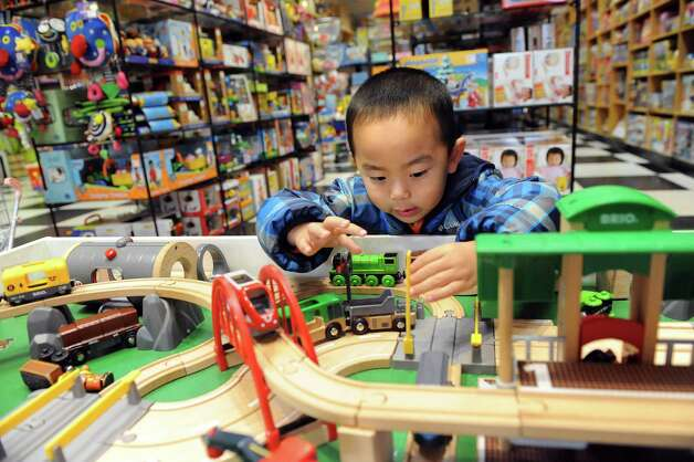 Jonathan Wu, 3, plays with a train set on Thursday, Nov. 20, 2014, at G. Willikers in Guilderland, N.Y. (Cindy Schultz / Times Union) Photo: Cindy Schultz / 00029569A