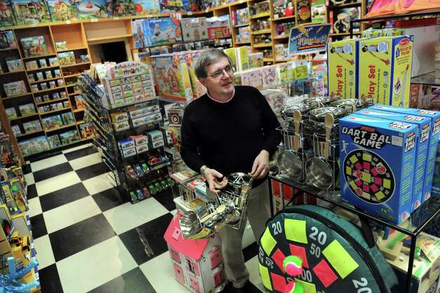 Store manager Kevin Murphy puts away toys from a new shipment on Thursday, Nov. 20, 2014, at G. Willikers in Guilderland, N.Y. (Cindy Schultz / Times Union) Photo: Cindy Schultz / 00029569A