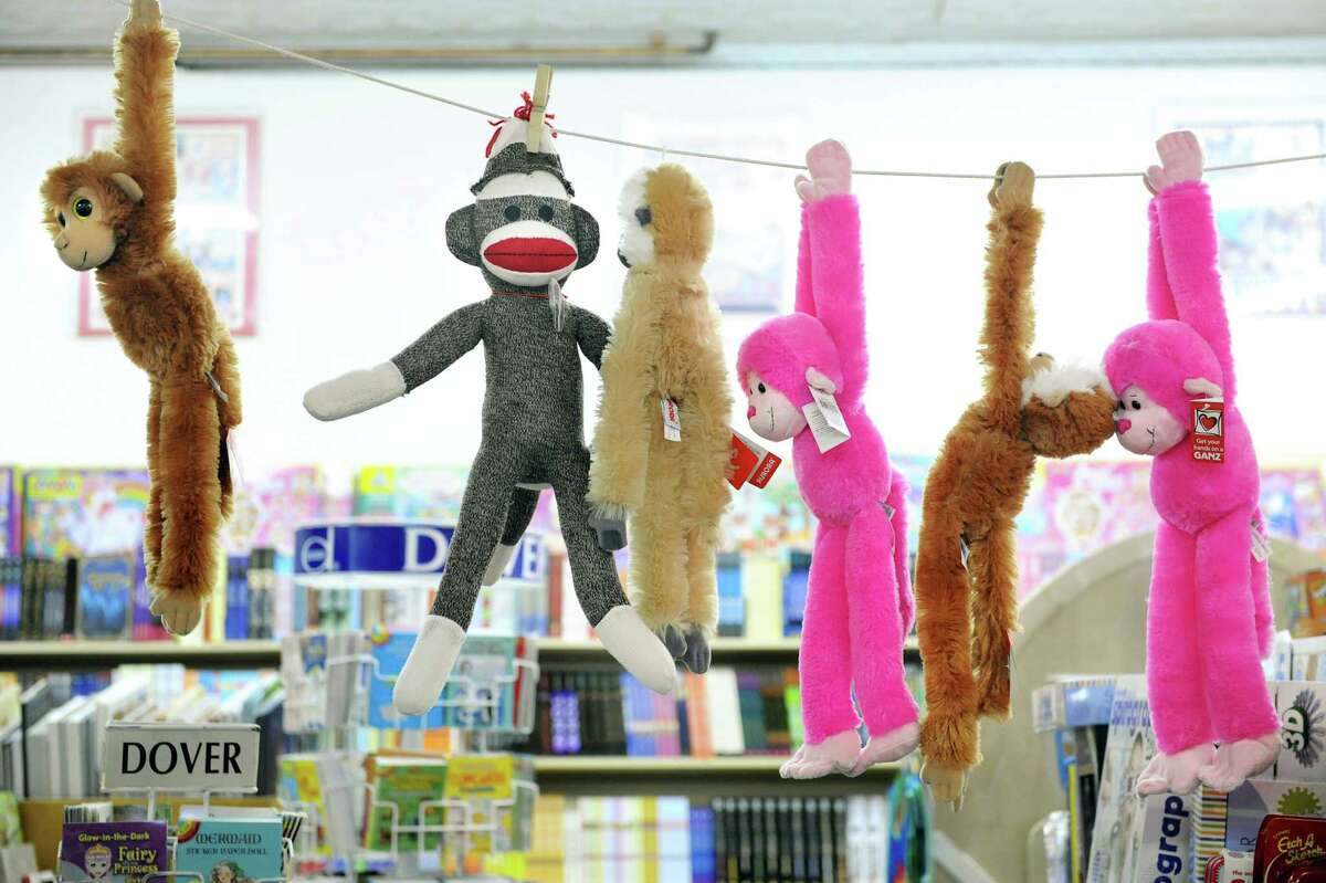 Stuffed animals and other gifts in the windows at the I Love Books store in Delmar.
