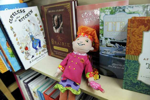A chef doll sits by the cook books on Tuesday, Nov. 25, 2014, at I Love Books in Delmar, N.Y. (Cindy Schultz / Times Union) Photo: Cindy Schultz / 00029619A