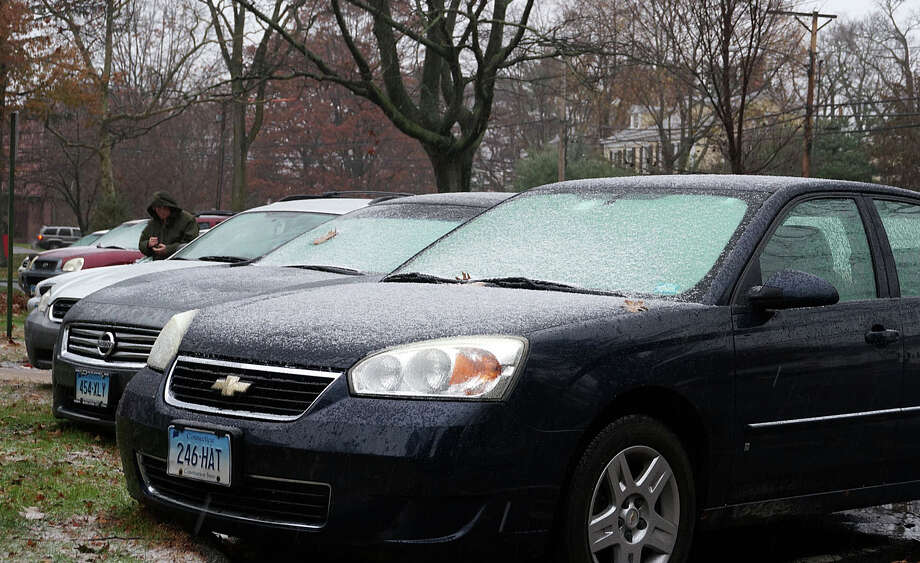 Rain and sleet -- with snow in the forecast -- gilded cars at Sullivan-Independence Hall on Wednesday as a Nor'easter-style storm closed in just before Thanksgiving. Photo: Genevieve Reilly / Fairfield Citizen