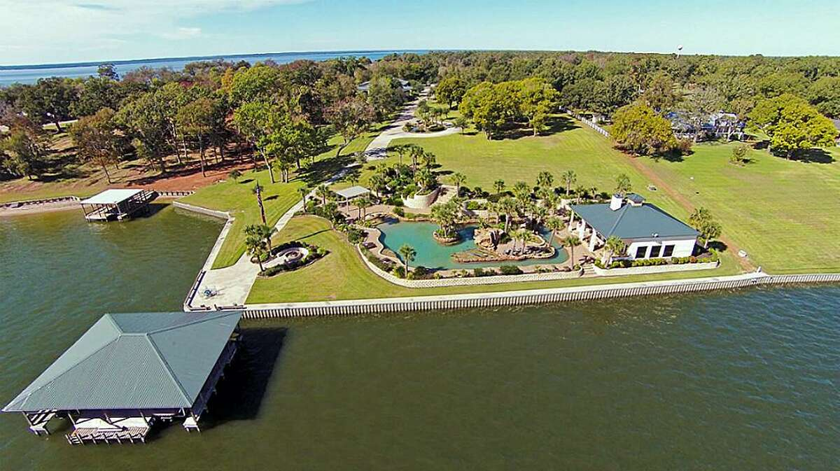 164 Tigerville (Livingston): The waterfront home on Lake Livingston sits on 6 acres and boasts possibly the largest private pool on the market, as well as a 15 car oversized garage and a