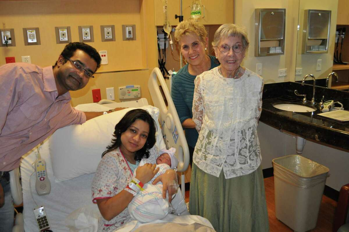 100-year-old Janet Unger and her daughter, Joan Davis, far right, visit Kushan Biswas, far left, and Tonima Paul and their baby girl, Utsa Biswas, to commemorate Janet's centennial birthday.