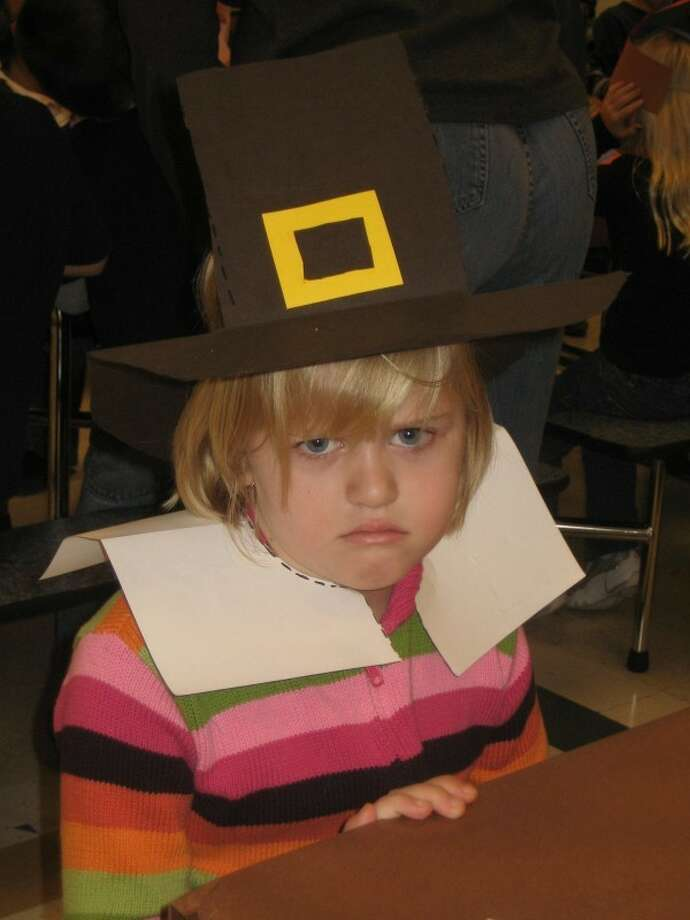 "Grumpy pilgrim: ""I want more pumpkin pie!"" Photo: Awkward Family Photos"