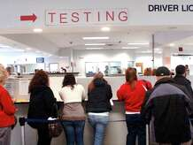 Residents wait in line at the Department of Motor Vehicles office in Danbury in this file photo.