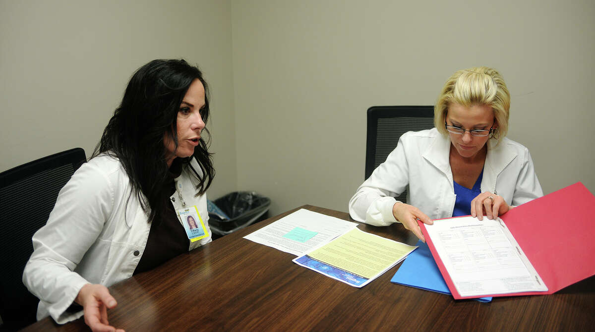 Patient care navigators Tiffany Simon Loncon, left, and Katie Powell talk about the process of guiding patients through chronic disease treatments Wednesday afternoon. Patient care navigators at the Smart Health Clinic of Baptist Hospitals of Southeast Texas assist patients with chronic diseases through the healthcare process, including health education and decision-making. Photo taken Wednesday 11/19/14 Jake Daniels/The Enterprise
