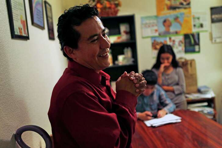 Rafael Vasquez and his children Daniel, 14, and Sara, 12, at their residence in Pittsburg, Calif., on Monday, November 24, 2014. Vasquez got laid off from his job last spring and SOS helped them with a few months' rent until he found new work.